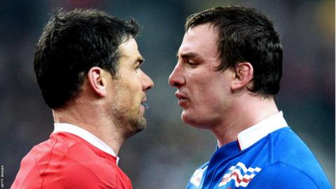 Wales scrum-half Mike Phillips exchanges pleasantries with France number eight Louis Picamoles