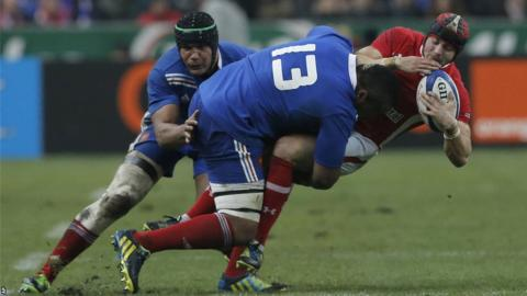 France centre Mathieu Bastareaud clatters Wales full-back Leigh Halfpenny