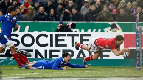 Wales wing George North gets past France replacement Francois Trinh-Duc to score a match-winning try