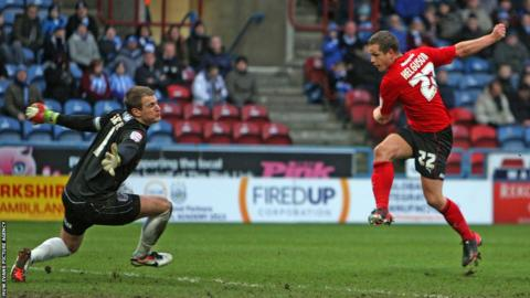 Heidar Helguson has a late effort saved by Huddersfield keeper Alex Smithies