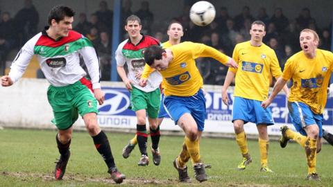 Jimmy Callacher heads in Glentoran's second goal in their 5-2 sixth round win over Bangor at Clandeboye Park