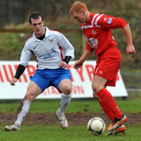 Ards defender Gary Spence moves in to challenge Joe McNeill of Portadown in the Irish Cup tie at Shamrock Park