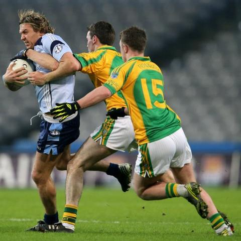 Former Tyrone county star Owen Mulligan comes under pressure from Pat Corridan and Raymond Galvin of Finuge