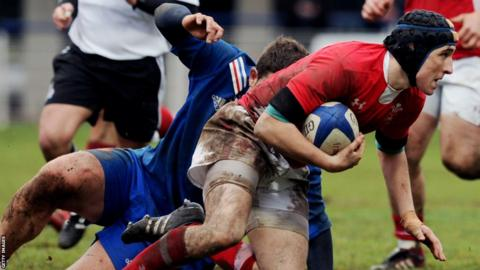 Outside-half Sam Davies gets away from a France tackler during Wales Under-20s' 27-13 win away in Clermont