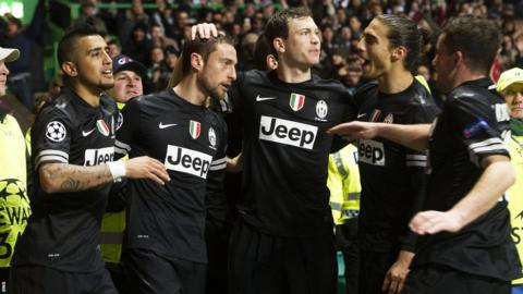 Juventus celebrate one of their three goals in the victory at Celtic Park