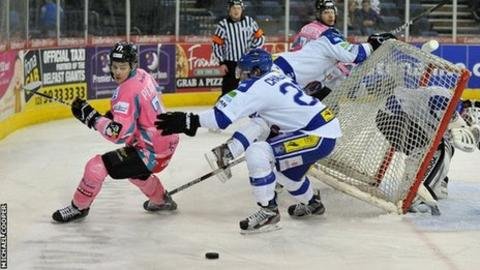 Belfast's Craig Peacock is challenged by Blaze opponent Stephen Chalmers