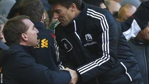 Manager Michael Laudrup (right) congratulates Liverpool boss Brendan Rodgers, his predecessor at Swansea, after the 5-0 loss at Anfield