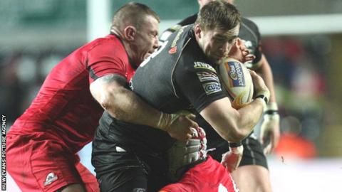 Ospreys try-scorer Morgan Allen is tackled by Edinburgh's John Yapp