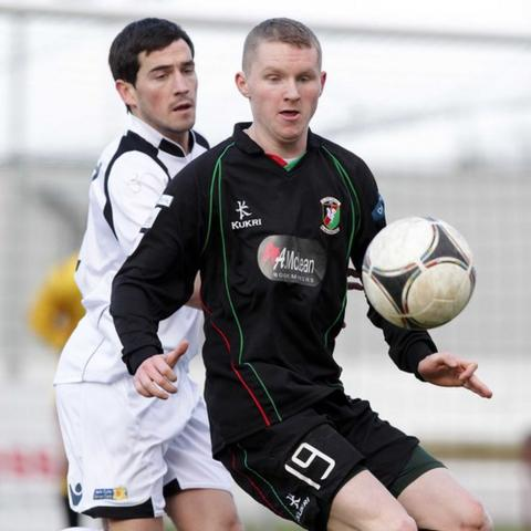 Lisburn Distillery defender Aaron Smyth closes in on Stephen McAlorum whose Glentoran side won 3-0 at New Grosvenor