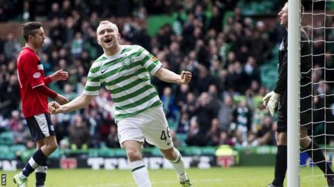 Dylan McGeough celebrates scoring Celtic's third goal