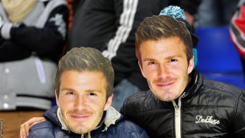 Two Paris St-Germain FC fans wear David Beckham masks during the Ligue 1 match between Sochaux and Paris Saint-Germain