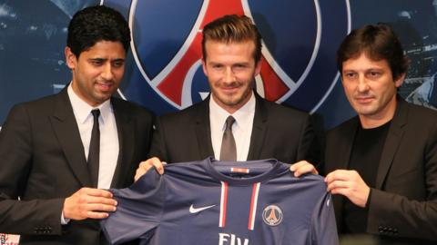 Flanked by president Nasser Al-Khelaifi and director of football Leonardo, David Beckham is presented to the media