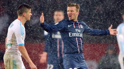 David Beckham came up against compatriot Joey Barton in a snowy Parc des Princes
