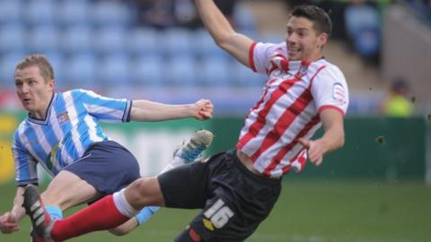 Aaron Martin challenges Gary McSheffrey in Coventry's FA Cup third round tie against Southampton, Jan 2012