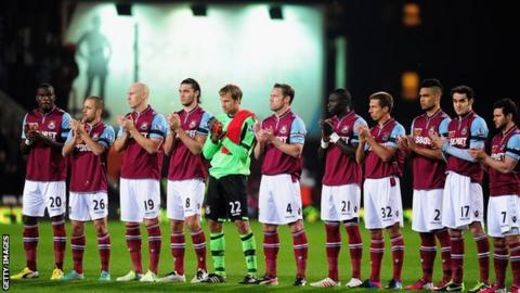 West Ham players led a minute's applause