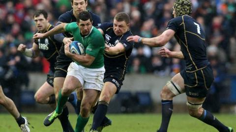 Rob Kearney is tackled by Scotland's Tim Visser, Duncan Weir and Kelly Brown