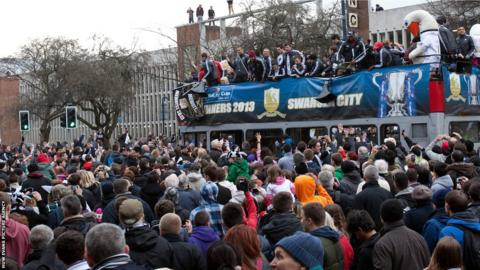 Some Swansea fans find a perch high above the crowds