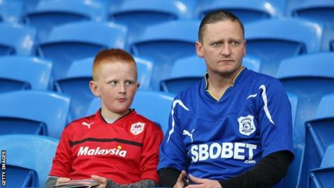 Cardiff City fans wearing contrasting club shirts