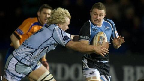 Cardiff Blues' Luke Hamilton tackles Glasgow Warriors' Duncan Weir