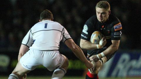 Newport Gwent Dragon Lewis Evans takes on Leinster's Jack O'Connell