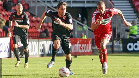 Cardiff City's Tommy Smith and Middlesbrough's Kieron Dyer compete for the ball in the Championship at the Riverside