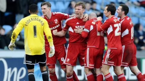 Swindon celebrate Darren Ward's last-minute winner at the Ricoh Arena