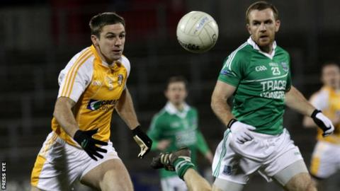 Antrim's Tony Scullion looks set to beat Martin McGrath to possession