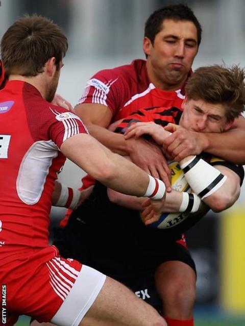 London Welsh fly-half Gavin Henson tackles Saracens wing David Strettle