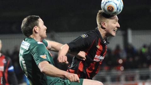 Cork's Denis Behan challenges Chris Morrow in the second leg
