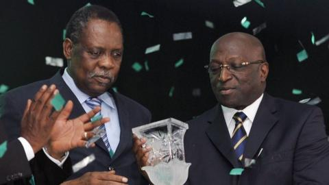 Confederation of African Football president Issa Hayatou (left) and Jacques Anouma