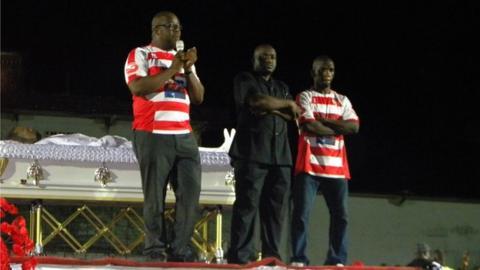 LFA President Musa Hassan Bility in black suit flanked by Former LFA President Edwin Snowe and Former Lone Star Ace midfielder Kelvin Sebwe
