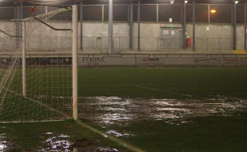 A waterlogged Princes Park pitch caused the postponement of Wrexham's Blue Square Bet Premier game at Dartford, although the game finally went ahead on Saturday.