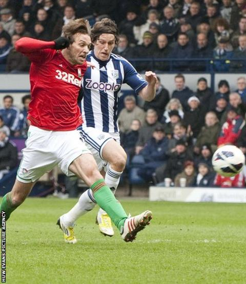 Michu shoots at goal during the first half of Swansea City's Premier League game at West Bromwich Albion.