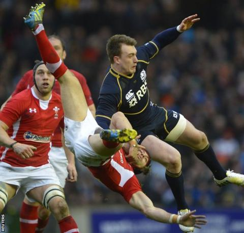 Scotland's Stuart Hogg challenges Wales full-back Leigh Halfpenny for a high ball