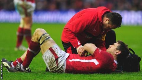 Wales back-row Ryan Jones receives treatment