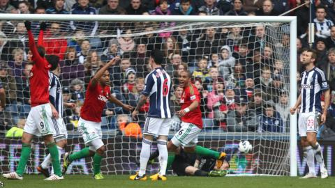 Luke Moore celebrates after putting Swansea ahead against West Brom