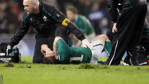 Eoin Reddan lies injured during the Six Nations match against France