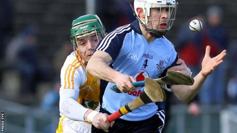 Benny McCarry challenges Dublin's Ruairi Trainor at Casement Park