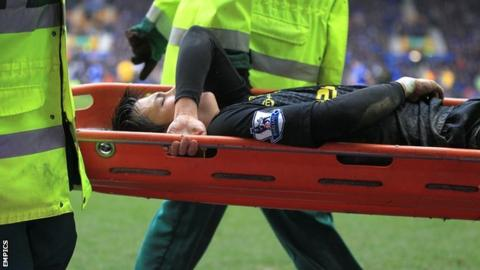 Wigan's on-loan winger Ryo Miyaichi is carried off on a stretcher against Everton