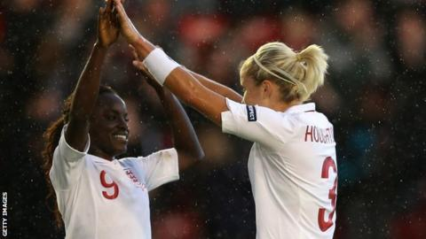 Eniola Aluko and Steph Houghton celebrate another England win