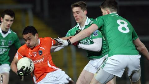 Armagh goal-scorer Jemar Hall is tackled by Fermanagh's Lee Breen