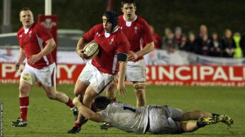Wales' Nicky Smith is tackled by England's man-of-the-match Luke Cowan-Dickie during the Under-20s Six Nations title decider in Colwyn Bay.