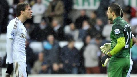 Swansea striker Michu and Arsenal goalkeeper Lukasz Fabianski exchange words at the finakl whistle.
