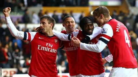 Substitute Gervinho celebrates with his team-mates after scoring Arsenal's second goal to secure a 2-0 win at the Liberty Stadium.