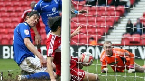 Birmingham striker Nikola Zigic scores