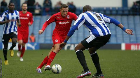 Cardiff City's Craig Bellamy takes on Sheffield Wednesday defender Reda Johnson during the Championship match at Hillsborough.
