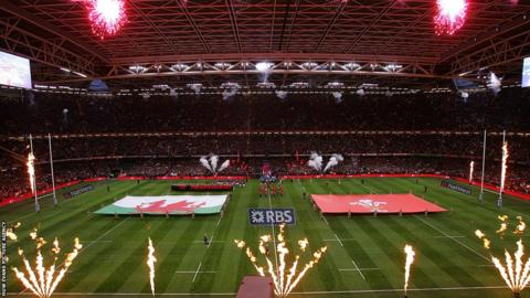 Fireworks welcome the teams to the pitch under the Millennium Stadium roof as Wales look to retain the Six Nations title and deny England a Grand Slam in the process