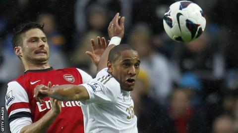 Ashley Williams challenges Arsenal Olivier Giroud