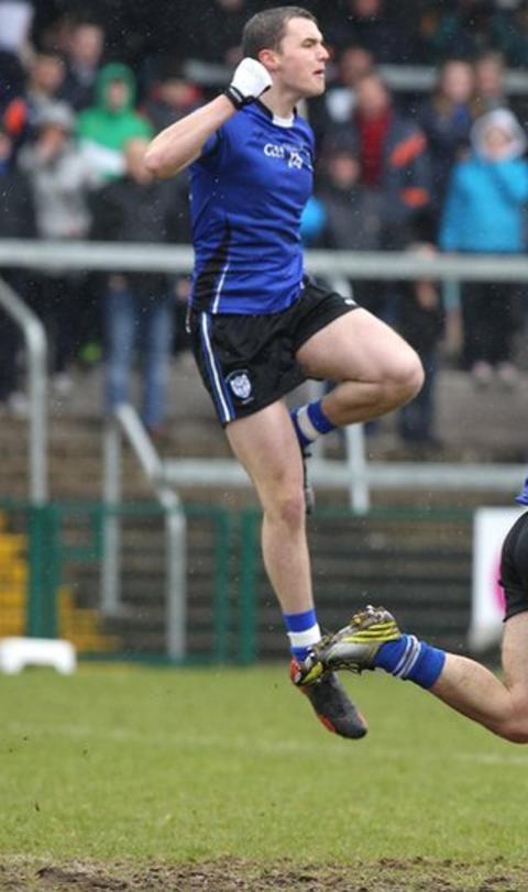 Conor Carville of St Pat's takes to the air as he celebrates scoring the opening goal in the MacRory Cup final