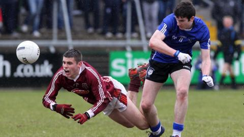 Gregory McCabe of St Paul's feels the full force of this challenge from St Pat's opponent Gerald Bradley